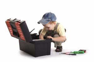 Little boy plays construction worker
